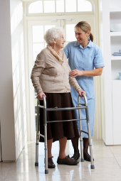 Cheerful eldery woman talking to care worker